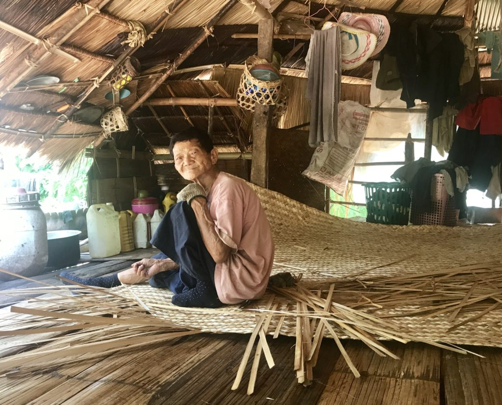 Old Man Weaving Bamboo